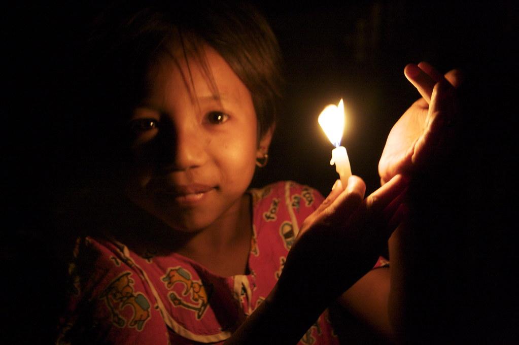Lighting Candles At The Shwezigon Temple, Bagan