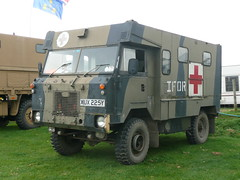 light commercial vehicle(0.0), armored car(1.0), military vehicle(1.0), vehicle(1.0), truck(1.0), land rover 101 forward control(1.0), armored car(1.0), land vehicle(1.0),