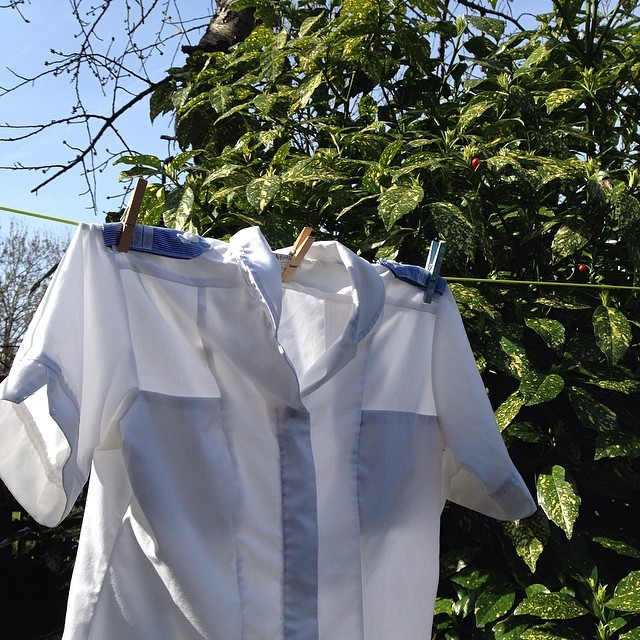 Fresh, white uniform hanging on the line. Very pleasing. #nursenancy #sunshine #laundry