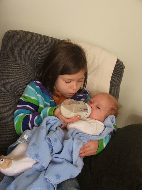 Beth giving Josiah a bottle