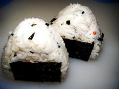 coconut(0.0), seaweed(0.0), food grain(0.0), california roll(0.0), side dish(0.0), sushi(0.0), gimbap(0.0), meal(1.0), steamed rice(1.0), rice(1.0), japanese cuisine(1.0), food(1.0), dish(1.0), cuisine(1.0), asian food(1.0), onigiri(1.0),