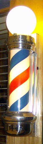 Photograph of lighted barber pole