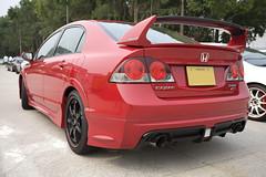 sports car(0.0), automobile(1.0), automotive exterior(1.0), wheel(1.0), vehicle(1.0), automotive design(1.0), rim(1.0), honda(1.0), honda civic type r(1.0), bumper(1.0), honda civic hybrid(1.0), sedan(1.0), land vehicle(1.0),