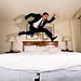 hotel room jump while wearing a suit by poopoorama