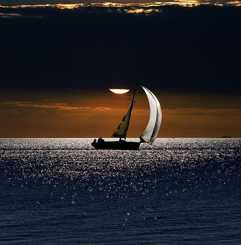 sunset sea costa aniversario river uruguay atardecer boat colonia barquito