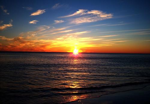 ocean light sunset sky sun color reflection beach nature water beautiful clouds florida panamacitybeach paintedsky aplusphoto perfectsunsetssunrisesandskys