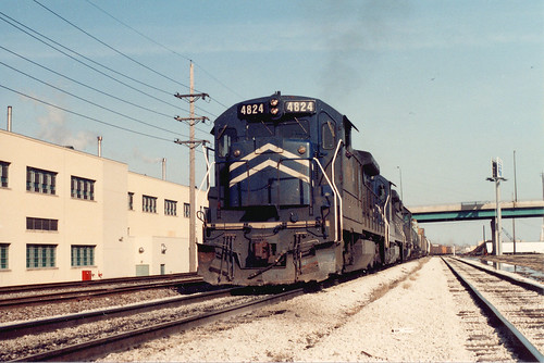 A westbound Union Pacific transfer train with former Missouri Pacific locomotives acquired through merger in 1982, heads toward Hayford Junction.  Chicago Illinois.  March 1985. by Eddie from Chicago