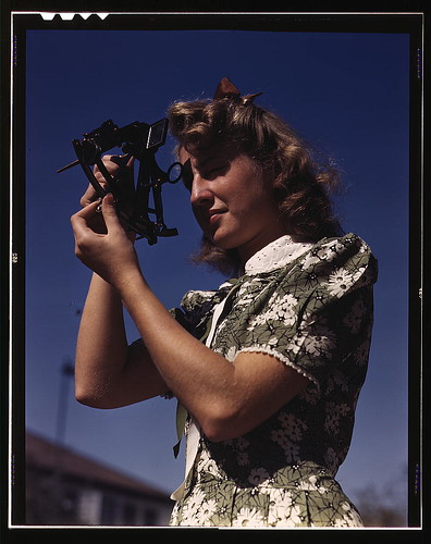 vintage photo of a girl wearing a 40s style green and white print cotton dress