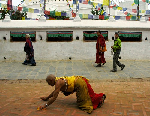 Tibetan Buddhist monk prostrator ... Boudha stupa, Buddhists, prayer flags, walkway, Boudha circle, Kathmandu, Nepal by Wonderlane