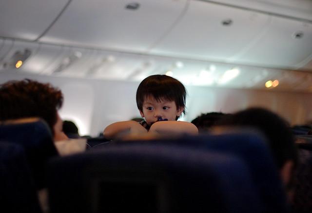 Excited Kid on Plane