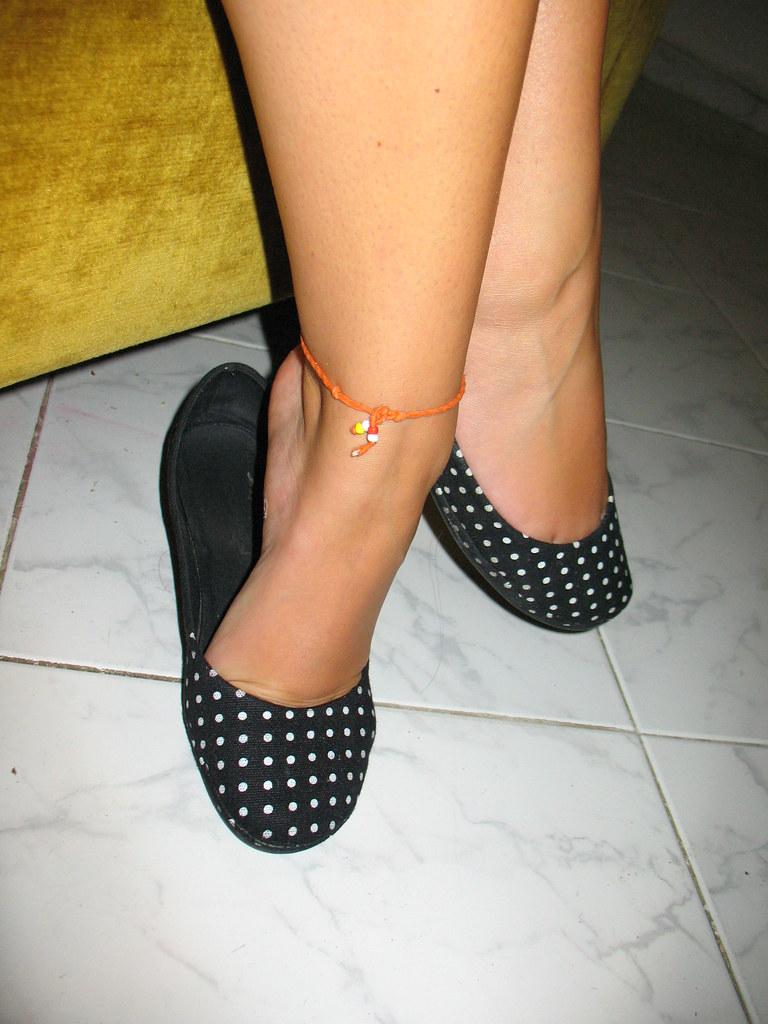 Dangling shoeplay in black stocking legs