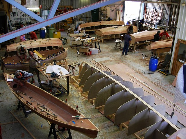 Duckflat residential boat building schools. Plans and kits for wooden boats.