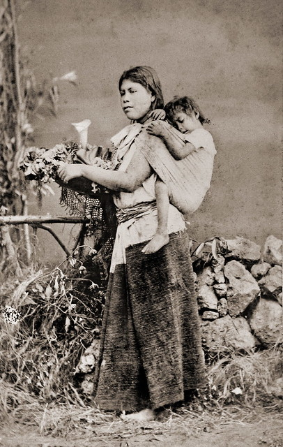 Mexican woman with child in baby sling