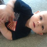 May 30th - Playing on the floor, wearing the US flag for his first Memorial Day.