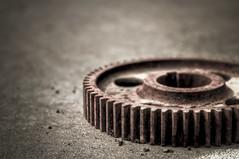 tire(0.0), automotive tire(0.0), wheel(0.0), monochrome(0.0), gear(1.0), macro photography(1.0), monochrome photography(1.0), close-up(1.0), iron(1.0), circle(1.0), black-and-white(1.0), black(1.0),