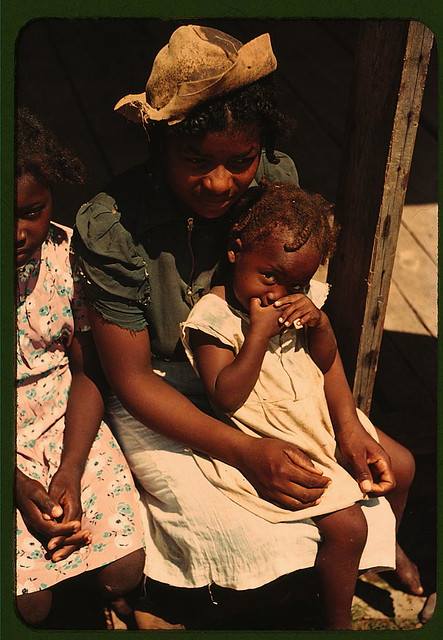 Bayou Bourbeau plantation, a Farm Security Administration cooperative, vicinity of Natchitoches, La. Three Negro children sitting on the porch of a house (LOC)