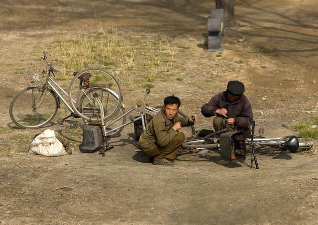 Repairing flat tires bikes - DPRK
