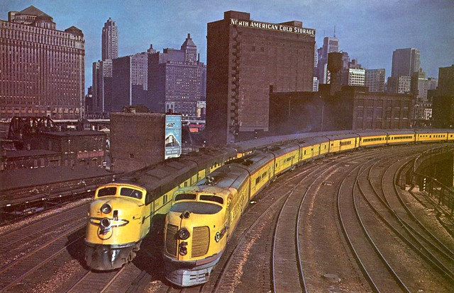 """Postcard - CNW, UP """"City of Denver"""" & the CNW """"Twin Cities 400"""" at Chicago, IL"""