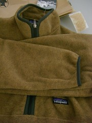 bag(0.0), wool(0.0), leather(0.0), textile(1.0), brown(1.0), clothing(1.0), khaki(1.0), outerwear(1.0), beige(1.0),