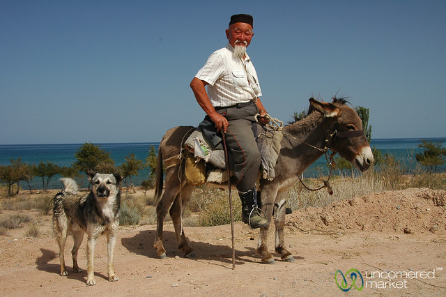 Kyrgyz Man and Dog - Lake Issyk-Kul, Kyrgyzstan