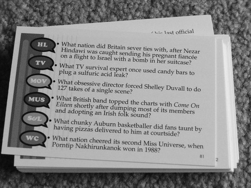 A trivia Pursuit card question side up