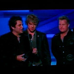 Rascall Flatts accepting either their Top Group award or their Humanitarian Award