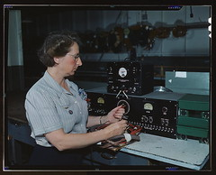 Working with the electric wiring at Douglas Aircraft Company, Long Beach, Calif.  (LOC)