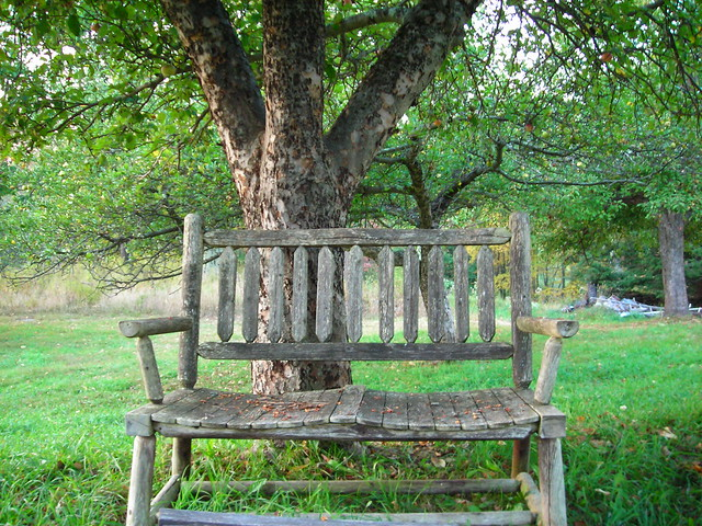 Rustic bench under apple tree flickr photo sharing for Benches that go around trees