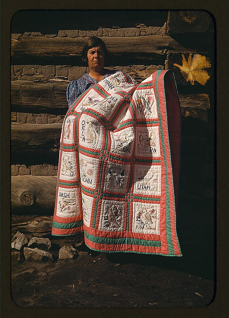 Mrs. Bill Stagg with state quilt which she made, Pie Town, New Mexico (LOC)