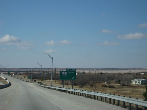 trees white west sign rural drive highway scenery long texas tour flat cloudy scene tourist line views interstate exit 20 leafless median sights prarie 225 westward offramp
