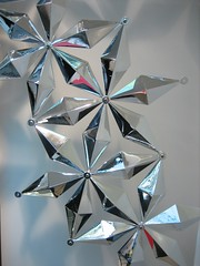 art paper(0.0), origami(0.0), wheel(0.0), christmas decoration(0.0), origami paper(0.0), lighting(0.0), art(1.0), symmetry(1.0), star(1.0), crystal(1.0),