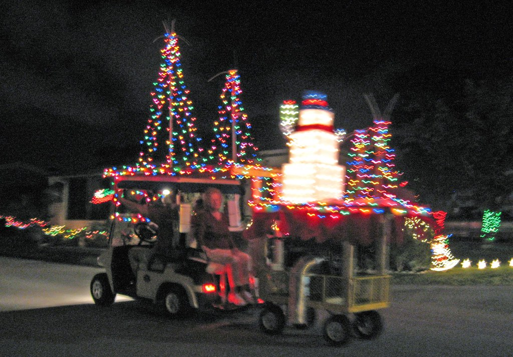 decorated golf cart pulling trailer - Golf Cart Christmas Decorations