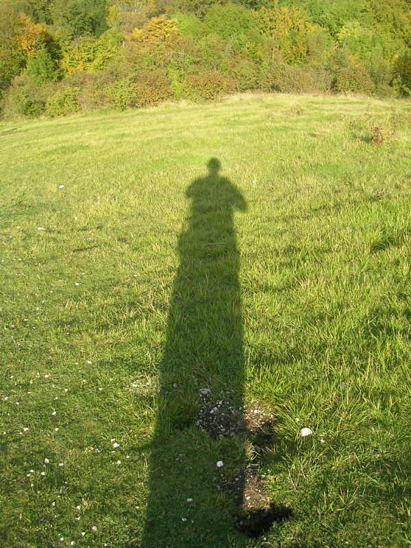 Tall shadow down steep hill Camera reveals my true stature Woolstonbury Hill. Burgess Hill to Hassocks