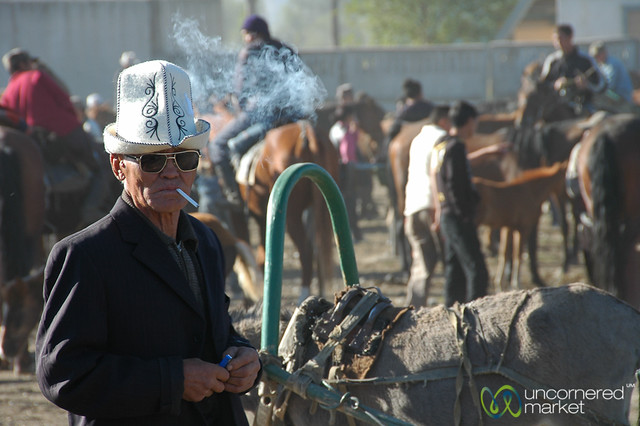 Old Kyrgyz Man with Kalpak, Smoking - Karakol, Kyrgyzstan