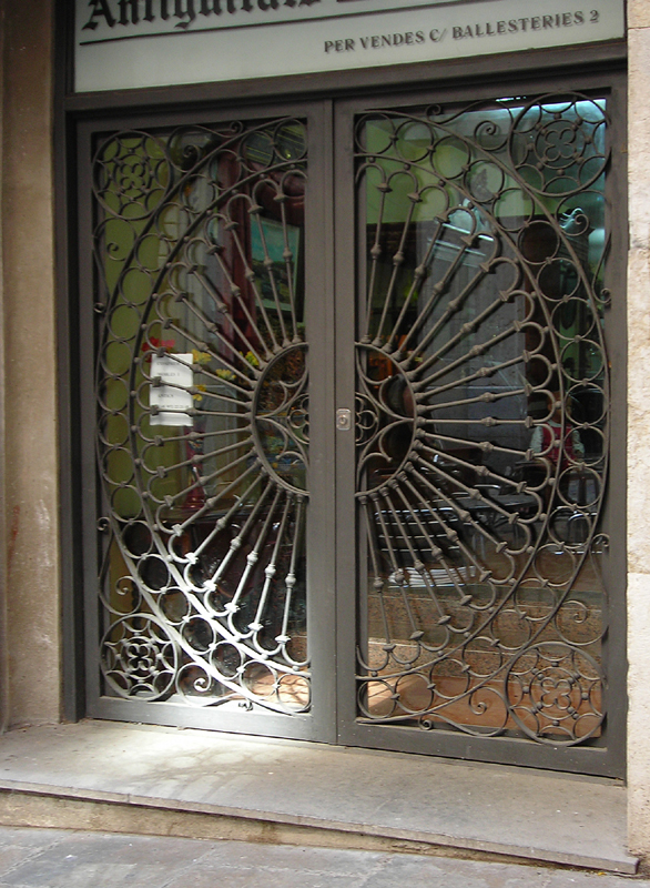Doors with circle-pattern security bars - a photo on ...