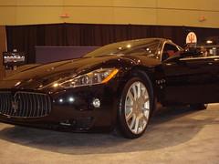 supercar(0.0), automobile(1.0), automotive exterior(1.0), maserati(1.0), vehicle(1.0), performance car(1.0), automotive design(1.0), auto show(1.0), maserati granturismo(1.0), sedan(1.0), land vehicle(1.0), luxury vehicle(1.0), sports car(1.0),