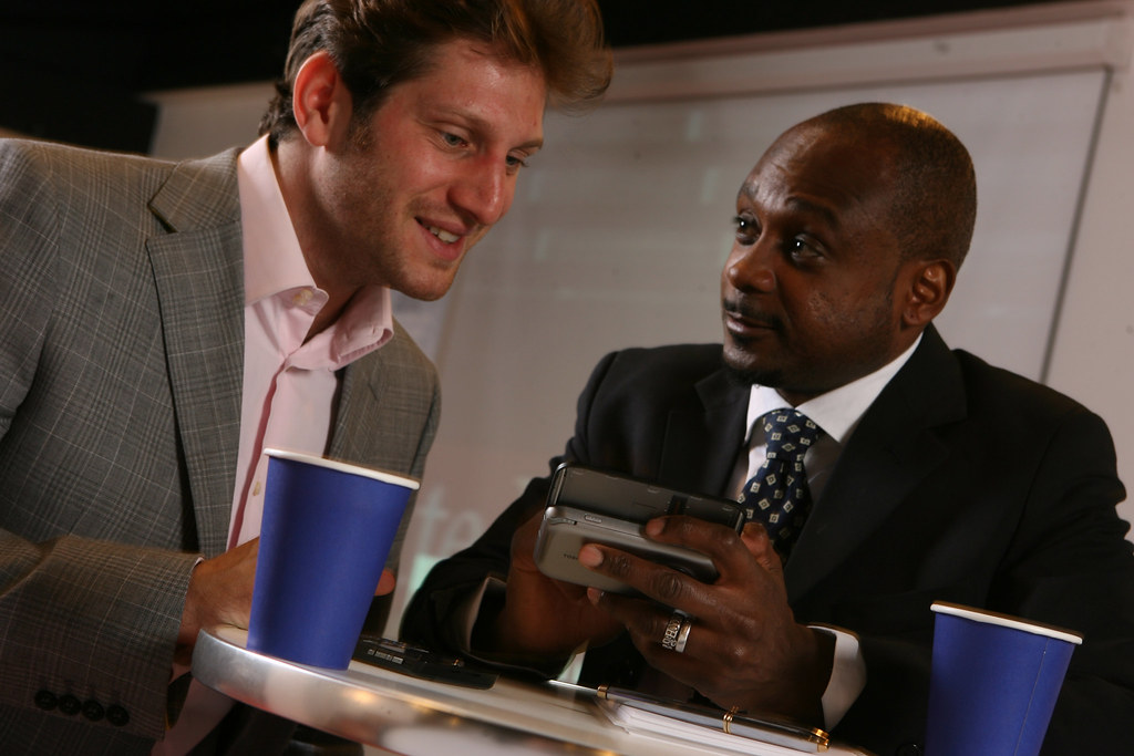 Business meeting in coffee shop with Windows Mobile devices