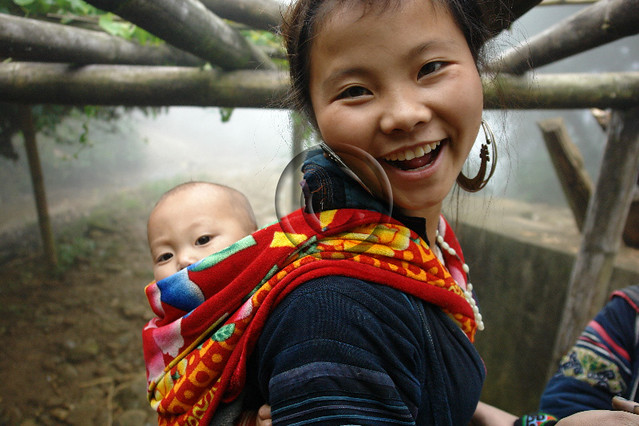 Black Hmong young mother and baby