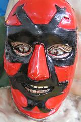 hockey protective equipment(0.0), clothing(0.0), wrestling(0.0), goaltender mask(0.0), costume(0.0), headgear(0.0), masque(1.0), red(1.0), mask(1.0),