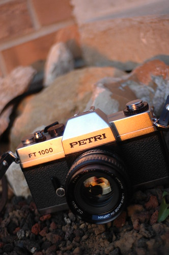 camera sunset orange black film vertical 35mm silver lens rocks petri carenar