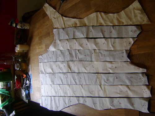 the strips cut with the pattern paper still pinned on