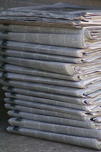 Newspaper pile. Valerie Everett/Flickr