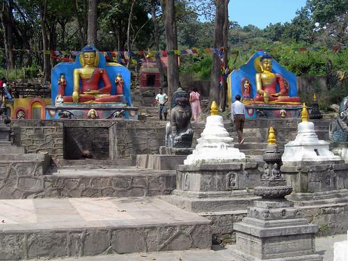 Buddha statues, chorten (reliquary monuments), fresh prayer flags, stairs leading to Swayambhunath (स्वयम्भूनाथ स्तुप), Kathmandu, Nepal - photo by Steve D. by Wonderlane