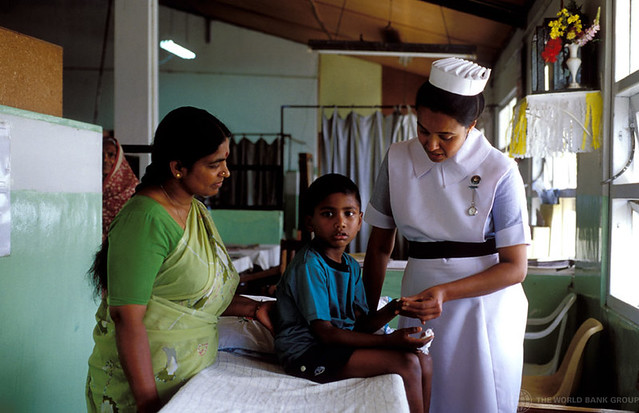 Mother and boy being attended to by Health Education nurse