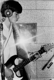 ギターをもってた少年
