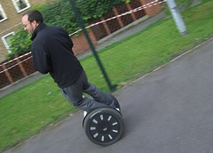 unicycle(0.0), bicycle motocross(0.0), kick scooter(0.0), training wheels(0.0), bmx bike(0.0), lawn(0.0), cart(0.0), wheel(1.0), vehicle(1.0), segway(1.0), land vehicle(1.0),