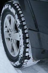 bumper(0.0), tire(1.0), automotive tire(1.0), automotive exterior(1.0), wheel(1.0), synthetic rubber(1.0), tread(1.0), rim(1.0), alloy wheel(1.0), monochrome(1.0), black-and-white(1.0), spoke(1.0),