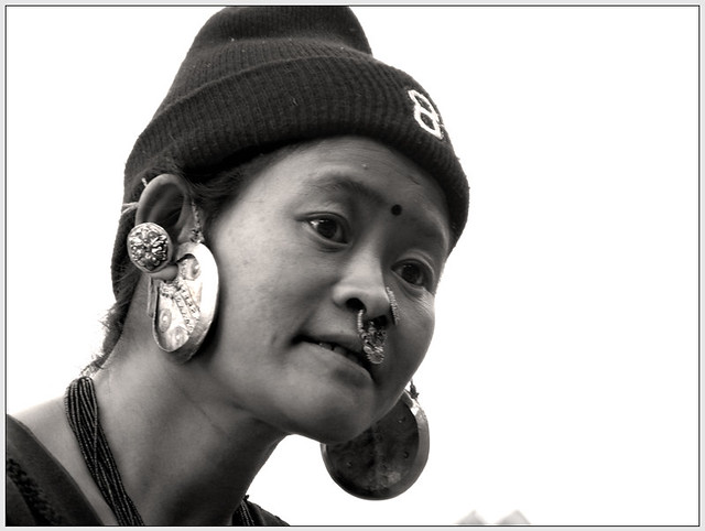 A Limbu Lady in front of a temple