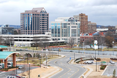 A view of downtown Huntsville and Big Spring Park, shot on a cloudy day from the roof of the Huntsville Public Library.