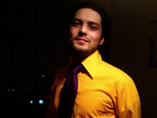 Karoli's wear: yellow shirt & purple tie